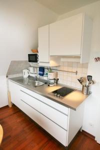 Küche/Küchenzeile in der Unterkunft Ferienwohnungen Wyk/Föhr