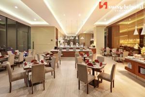 Restaurant ou autre lieu de restauration dans l'établissement Swiss-Belhotel Sorong
