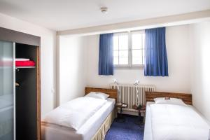 A bed or beds in a room at Sorell Hotel Rüden