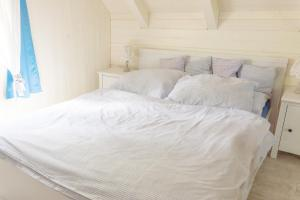 A bed or beds in a room at Chata Monika