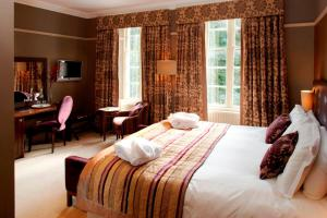 A bed or beds in a room at Rothay Garden Hotel & Riverside Spa