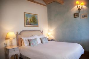 מיטה או מיטות בחדר ב-Amaryllis Boutique Guest House