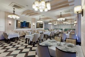Restoranas ar kita vieta pavalgyti apgyvendinimo įstaigoje Saphir Hotel