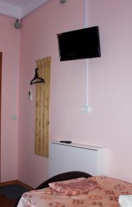 Телевизор и/или развлекательный центр в Комнаты Life Apart
