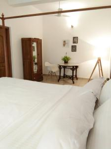 A bed or beds in a room at Botanique Goa
