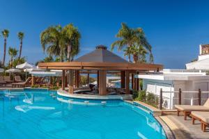 The swimming pool at or near Mediterranean Beach Hotel