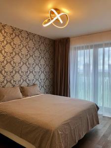 Кровать или кровати в номере CE Apartment Castle View