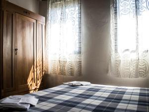 Letto o letti in una camera di Locanda Casa Motta