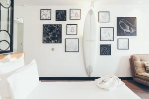 Ein Bett oder Betten in einem Zimmer der Unterkunft Hôtel & Spa Villa Seren