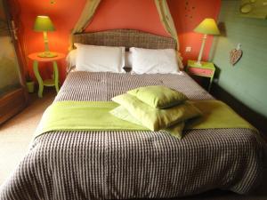 Un ou plusieurs lits dans un hébergement de l'établissement B&B L'Albatros