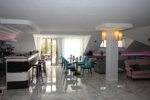 A restaurant or other place to eat at Hotel Naxos B&B