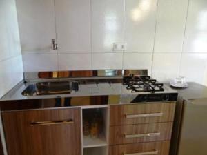 A kitchen or kitchenette at Eliconial Paraty Pousada