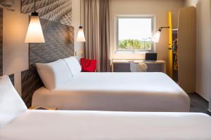 Cama o camas de una habitación en Ibis Mazatlan Marina