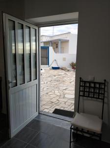 A balcony or terrace at Sleep & Go Faro Airport Guest House