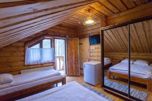 Кровать или кровати в номере Парк Отель Архангельская Слобода