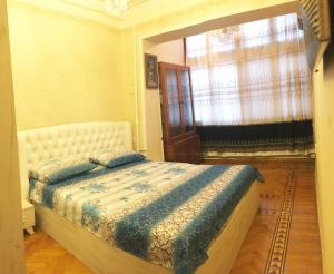 Cama ou camas em um quarto em Icheri Sheher Apartment