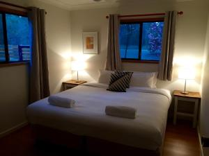 A bed or beds in a room at Belford Cottages