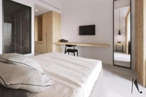 A bed or beds in a room at New Aqua Hotel