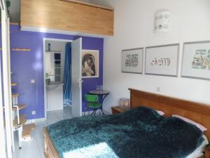 Un ou plusieurs lits dans un hébergement de l'établissement Le Maribo