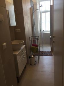 A bathroom at Candussi-Apartments