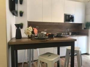 A kitchen or kitchenette at Center Arena Design Apartments with terrace