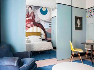 Ein Bett oder Betten in einem Zimmer der Unterkunft Amor de Dios 17 Boutique Hotel