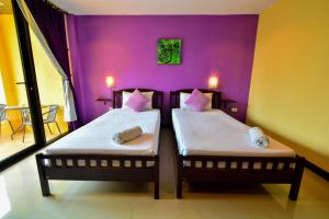 A bed or beds in a room at Gecko Hotel