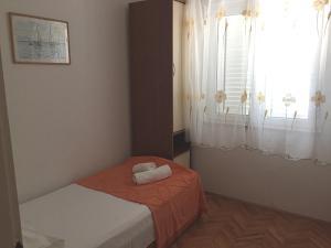 A bed or beds in a room at Apartments Vesna
