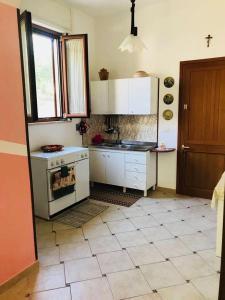 Cucina o angolo cottura di Casa in Via Sardegna