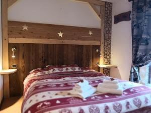 A bed or beds in a room at Hotel Chalet Del Sole