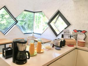 A kitchen or kitchenette at Mir Guesthouse