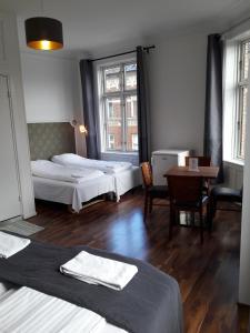 Cama ou camas em um quarto em Hotel Løven