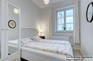 Łóżko lub łóżka w pokoju w obiekcie Apartament Długa Street
