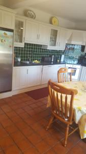 A kitchen or kitchenette at Tulla Villa Self Catering