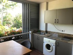 A kitchen or kitchenette at Port Douglas Penthouse Suite