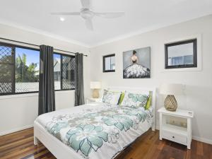 A bed or beds in a room at Palm Beach Hideaway, Queensland