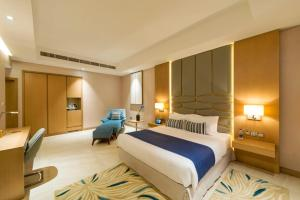 A bed or beds in a room at Canal Central Hotel