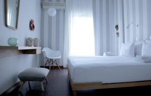 Кровать или кровати в номере Liotopi