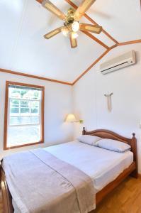 パノラマ・オーシャンビュー・コテージにあるベッド