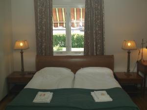 Säng eller sängar i ett rum på Hotel Laurenti