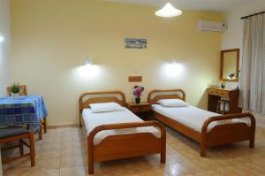 A bed or beds in a room at Nikos 2 Studios & Apartments