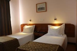 A bed or beds in a room at Apartamentos Turisticos Verdemar