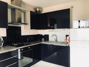 A kitchen or kitchenette at Appartement Sous le Soleil