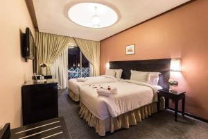 Cama o camas de una habitación en Hotel Almas