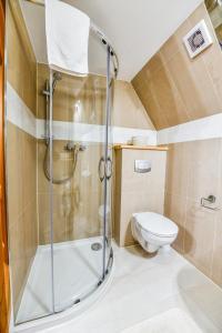 A bathroom at Pokoje Gościnne Makuszyńskiego