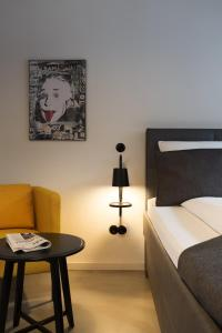 A bed or beds in a room at Square Rooms