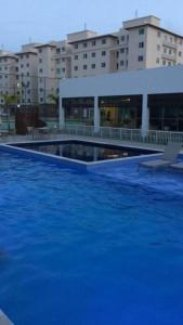 The swimming pool at or near Conforto - VOG Torres do Sul Ilhéus