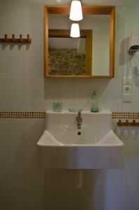 Un baño de Apartamentos Playa Galizano