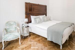 A bed or beds in a room at House Beletage