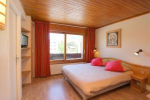 Un ou plusieurs lits dans un hébergement de l'établissement Hotel le Sherpa